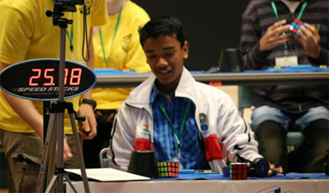 Kid Solves Rubik Cube In Seconds